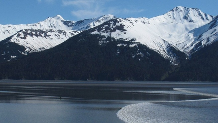 June 5: The biggest bore tide of the summer roared into Turnagain Arm south of Anchorage, Alaska.