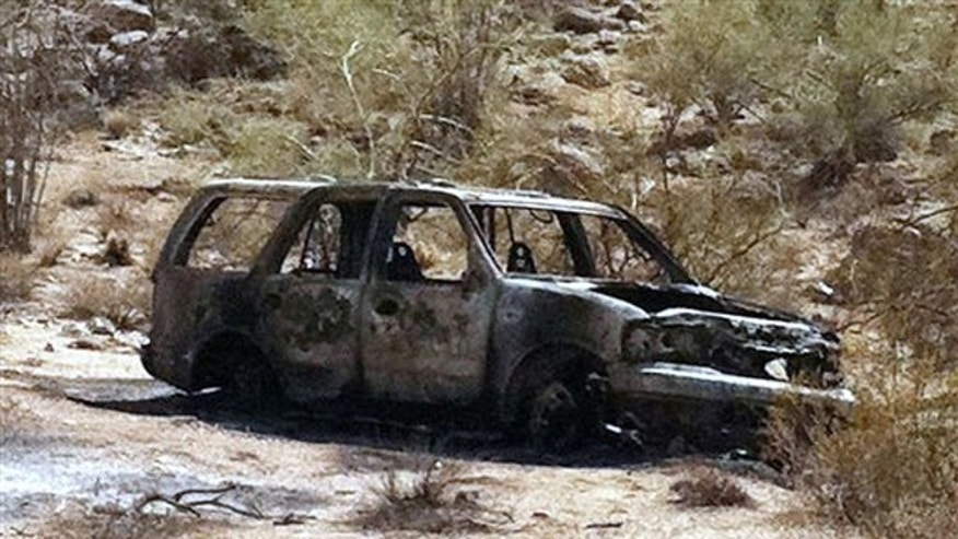 This image provided by the Pinal County Sheriffs Office, shows the vehicle where five burned, dead bodies were found, in Pinal County's Vekol Valley area, west of Casa Grande, Ariz.