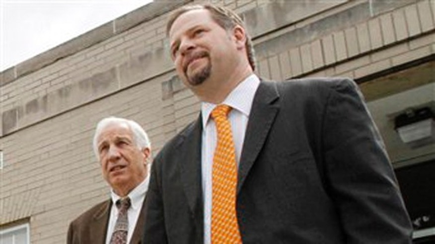 June 6, 2012: Former Penn State University assistant football coach Jerry Sandusky, left, leaves with his assistant attorney Karl Reminger after jury selection was completed for Sandusky's trial at the Centre County Courthouse in Bellefonte, Pa.