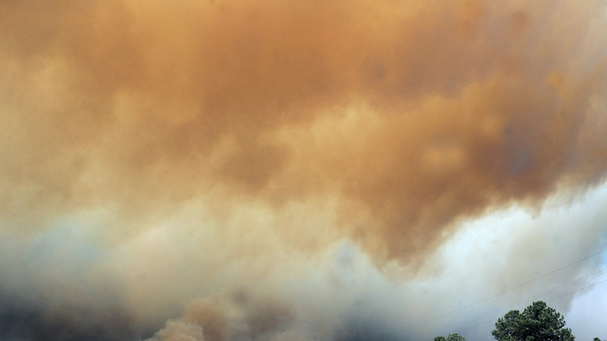 June 9: Smoke billows from the Little Bear fire in southeastern New Mexico near Ruidoso.