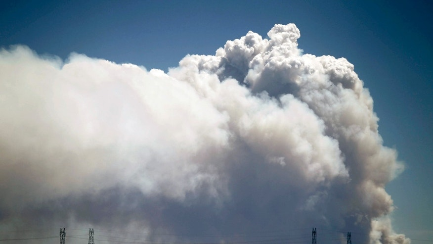 June 9, 2012: Smoke is visible from Tie Siding, Wyo., as a wildfire burns northwest of Fort Collins, Colo.