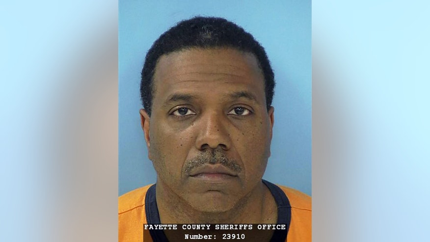 June 8, 2012: This photo provided by the Fayette County Sheriff's Office shows megachurch pastor Creflo Dollar.