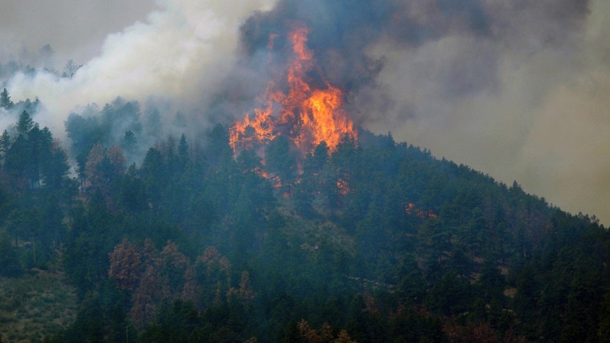 June 11: A wildfire burns out of control near Fort Collins, Colorado. The fire grew to more than 31 square miles within about a day after being reported.