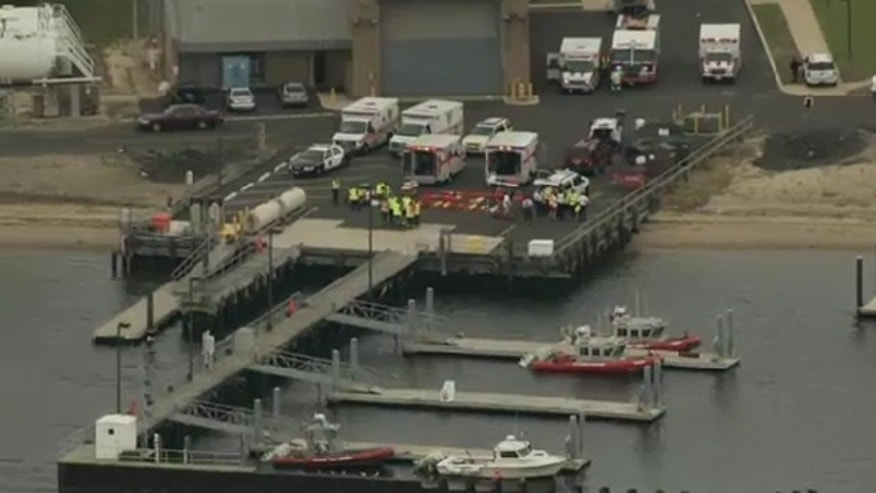 June 11. 2012: First responders gather after report of yacht explosion in New Jersey.