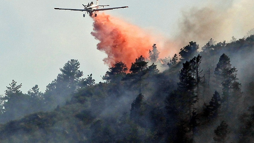 June 11: A slurry bomber drops a load of retardant on the High Park wildfire near Fort Collins, Colorado.