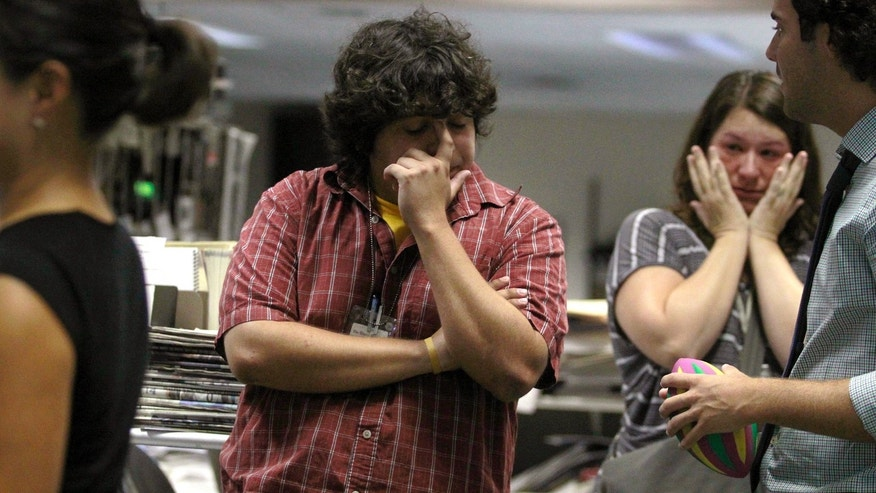 June 12: Reporter Ramon Vargas, center, waits for his meeting and St. Tammany reporter Christine Harvey cries after not being offered a position with the new Nola Media Group.