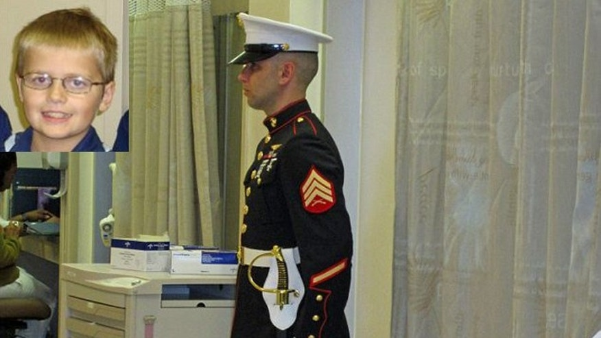 This Marine stood guard outside Cody Green's hospital room all night as the boy, who was made an honorary member of the Corps,  lay dying.