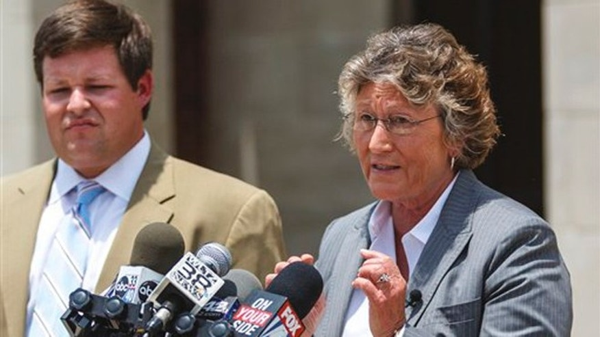 June 14, 2012: Susan James, of Susan James & Associates of Montgomery, right, with fellow attny. Garrett Saucer, left, gives a press conference at the Russell County Judicial Center in Phenix City, Ala., to discuss representing Desmonte Leonard