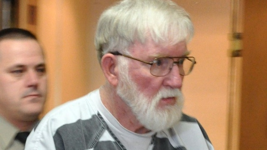 Feb. 2, 2012: In this file photo, Carl V. Ericsson, 73, is led into a Lake County courtroom for a bond hearing on a first-degree murder charge in Madison, S.D. Ericsson was sentenced to life in prison, after pleading guilty but mentally ill last month to second-degree murder.