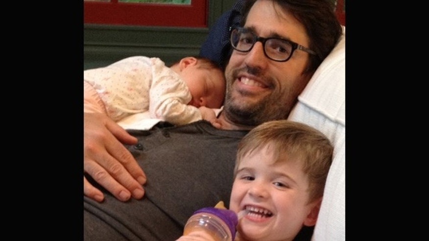 Bryan Grossbauer, 35, with his 7-week-old daughter, Georgina, and his son Finn, who left his job in the education field after he and his wife determined that her income as an attorney provide enough financial stability.