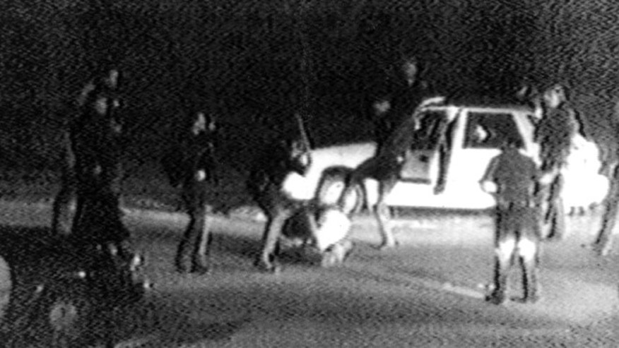 March 31, 1991: FILE - This  image made from video shot by George Holliday shows police officers beating a man, later identified as Rodney King.