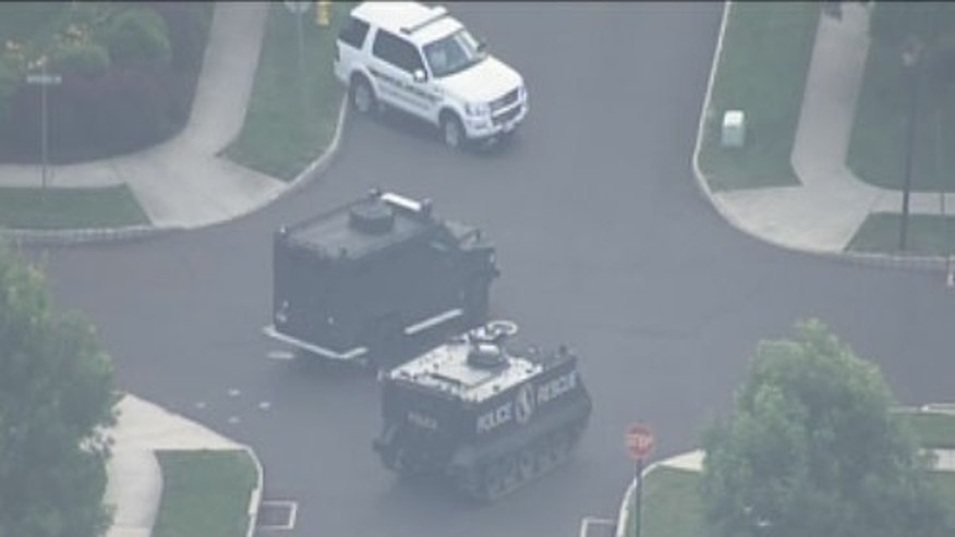June 17, 2012: The scene outside of a Pennsylvania home as cops engage in standoff with armed suspect.