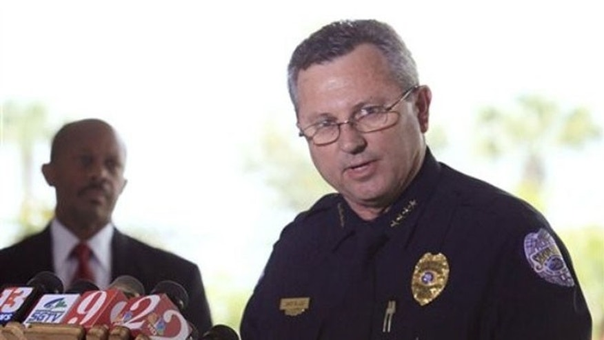 In this March 22, 2012 file photo, Sanford Police Chief Bill Lee speaks to the media during a news conference as city manager Norton Bonaparte Jr. listens at left, in Sanford, Fla.
