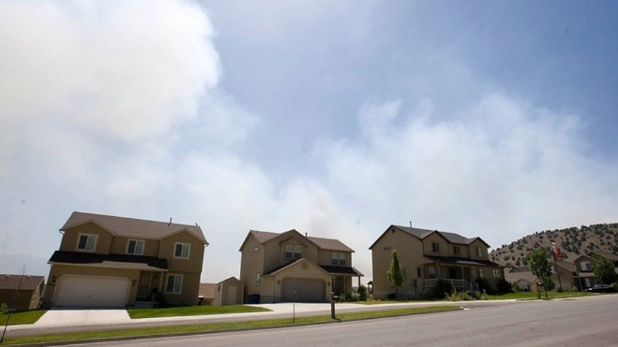 June 22, 2012: Smoke fills the sky as a fire burns near Eagle Mountain, Utah.