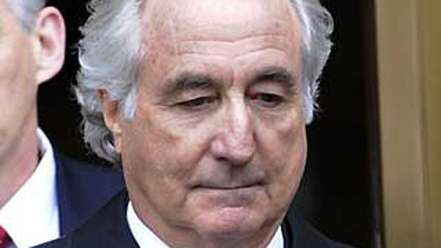 In this March 10, 2009 file photo, Bernard Madoff exits Manhattan federal court in New York.