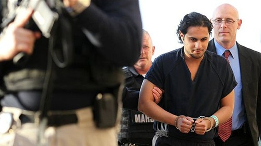 Feb. 25, 2011: In this file photo, Khalid Ali-M Aldawsari is escorted to court in Lubbock, Texas.