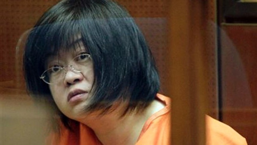 "March 16, 2012: Dr Hsiu Ying ""Lisa"" Tseng listens in court during her arraignment, in Los Angeles."