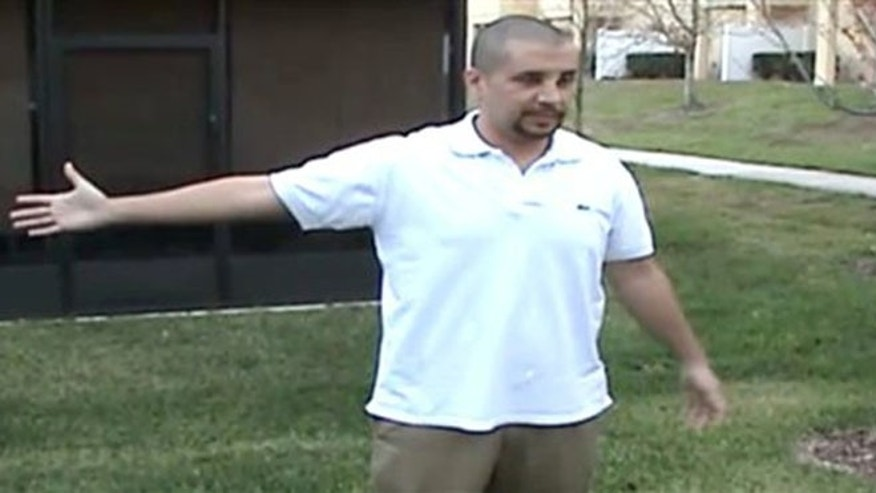 In this Feb. 27, 2012 image taken from a Sanford Police video posted on a website called gzlegalcase.com by George Zimmerman's defense team, Zimmerman speaks to investigators at the scene of Trayvon Martin's fatal shooting a day later giving police a blow-by-blow account of his fight with the teen.