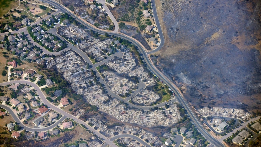 June 27, 2012: This aerial photo shows burned homes in the Mountain Shadows residential area of Colorado Springs, Colo., that were destroyed by the Waldo Canyon wildfire.