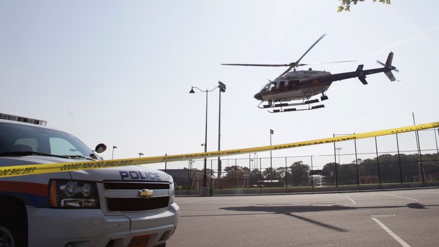 July 5: A police helicopter takes off from the scene of a news conference as part of an investigation into a fatal boating accident in Oyster Bay, N.Y.