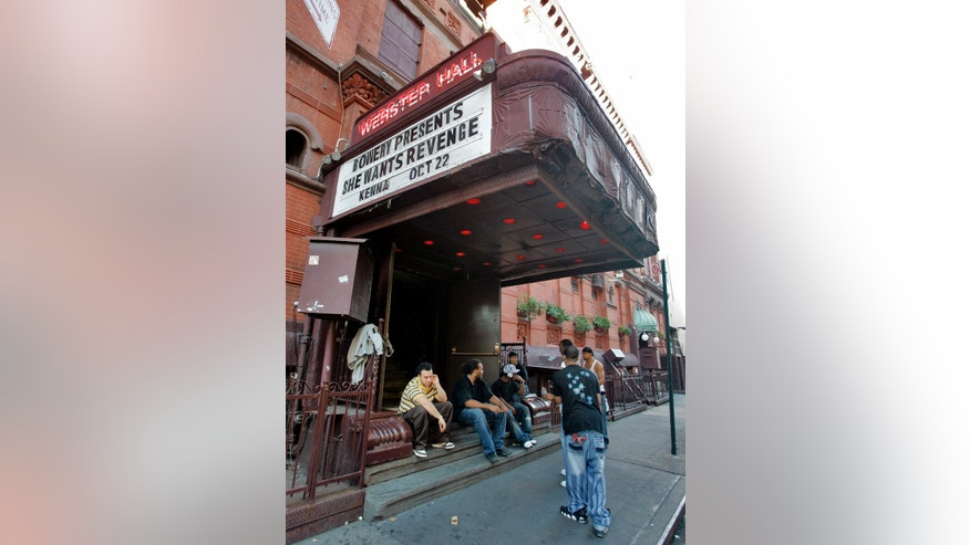 Oct. 22, 2007: In this file photo, workers at New York's Webster Hall take a break under the marquee.