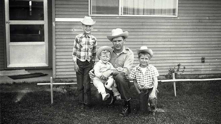 In this photo provided by Ron Thornton, Larry C. Thornton poses in a cowboy hat with his three sons, Dennis, Bradley and Ron, in this photo from the early 1960s taken while the family was stationed in Moses Lake, Wash.