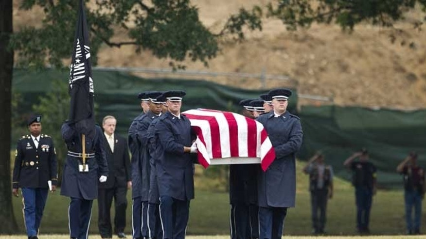July 9, 2012: An Air Force carry team carries the casket with the remains of Air Force Col. Joseph Christiano, Col. Derrell B. Jeffords, Lt. Col. Dennis L. Eilers, Chieft Master Sgt. William K. Colwell, Chief Master Sgt. Arden K. Hassenger and Chief Master Sgt. Larry C. Thornton, during a burial service at Arlington National Cemetery Arlington, Va.