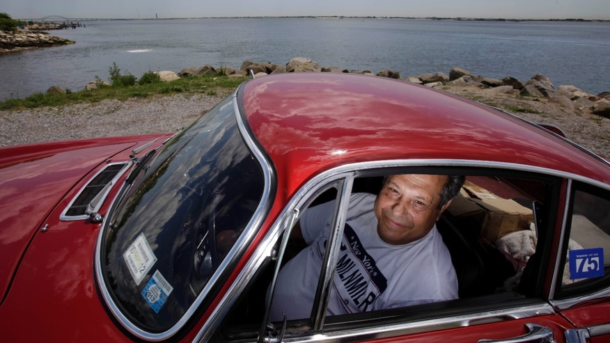 July 2, 2012: Irv Gordon poses for a picture in his Volvo P1800 in Babylon, N.Y.
