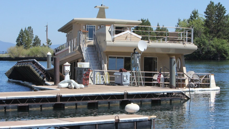 July 9, 2012: The luxury yacht the Sierra Rose, sits partially submerged at its Tahoe Keys Marina dock in South Lake Tahoe, Calif.  Witnesses say the three-story yacht that recently sold for $3.2 million sunk in a Lake Tahoe marina.