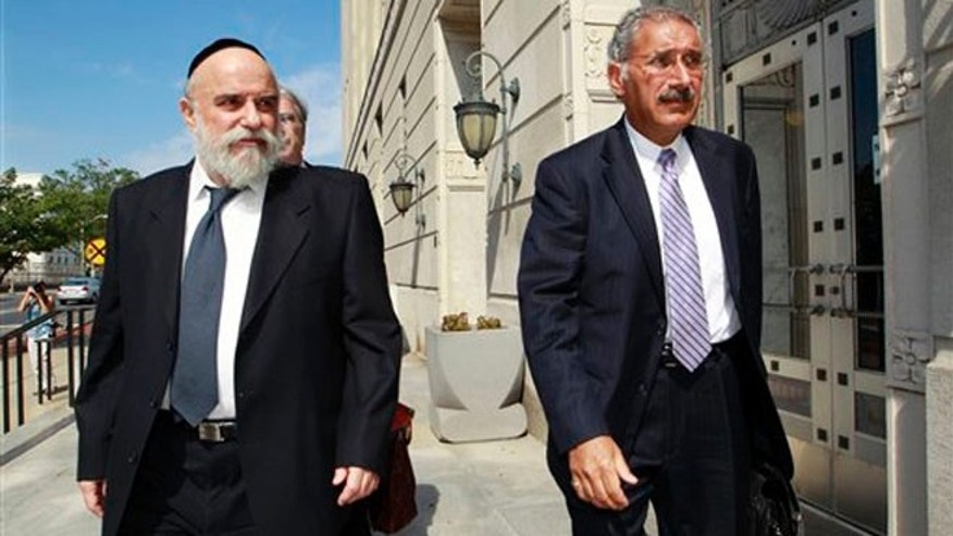 July 11, 2012: Levy Izhak Rosenbaum, left, of Brooklyn, N.Y, arrives for his sentencing in Trenton, N.J., for what prosecutors say is the first ever federal conviction for illegally selling human kidneys for profit.