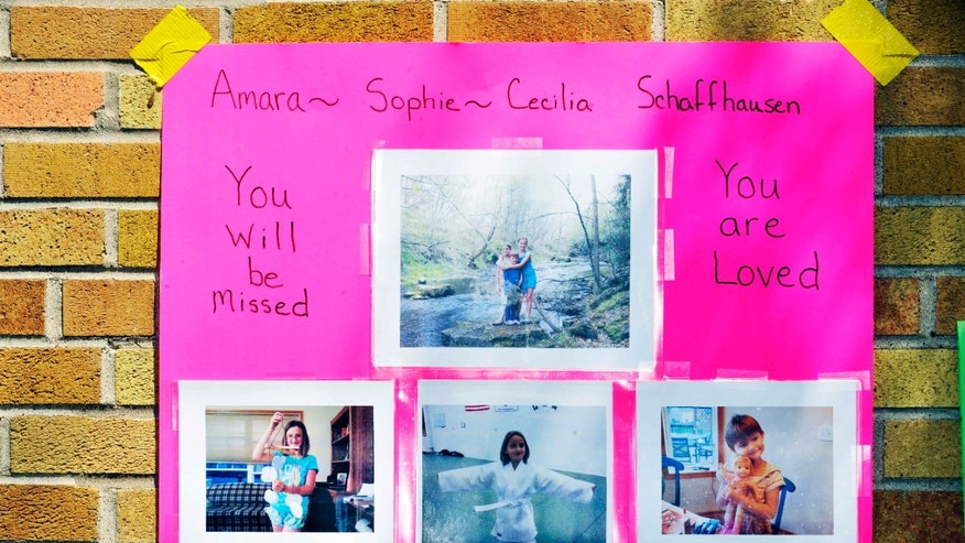 July 11, 2012: Pictures (bottom row from left) of Amara, 11, Sophie, 8, and Cecilia, 5 are shown outside Greenwood Elementary School.