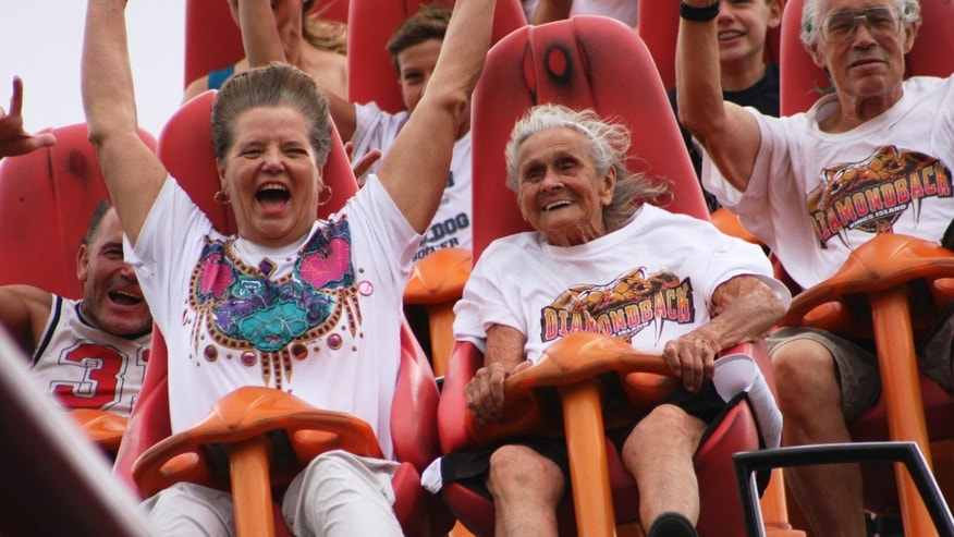 July 13, 2012: In this photo provided by Kings Island, Thelma Gratsch, center, celebrates her 90th birthday by riding her favorite roller coaster, Diamondback, at Kings Island amusement park in Mason, Ohio.
