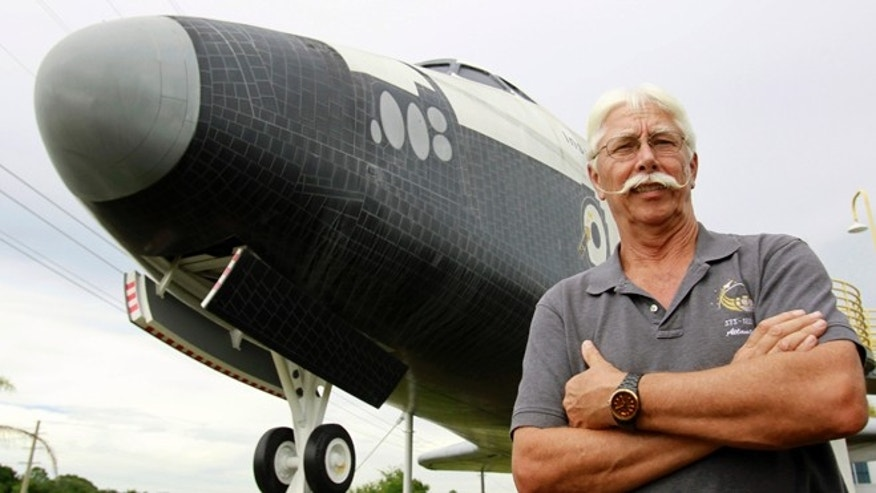 July 11, 2012: Former space shuttle worker Terry White poses in front of a mock space shuttle at the Astronaut Hall of Fame in Titusville, Fla. White was a project manager who worked 33 years for the shuttle program until he was laid off after Atlantis landed last July 21.