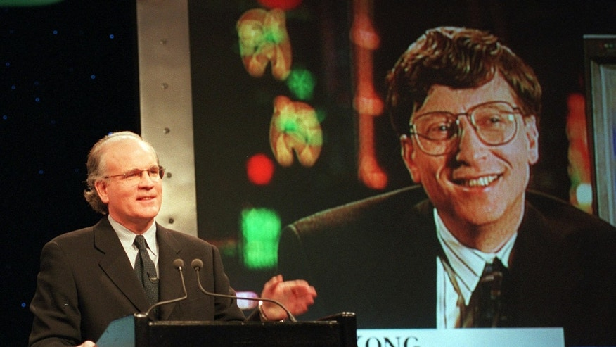FILE: Robert Wright, president and chief executive officer of NBC, speaks in New York with Microsoft Chairman Bill Gates, displayed on screen, speaks from Hong Kong, during a news conference announcing that NBC and Microsoft would form a joint venture to start a cable news channel and related online service called MSNBC.