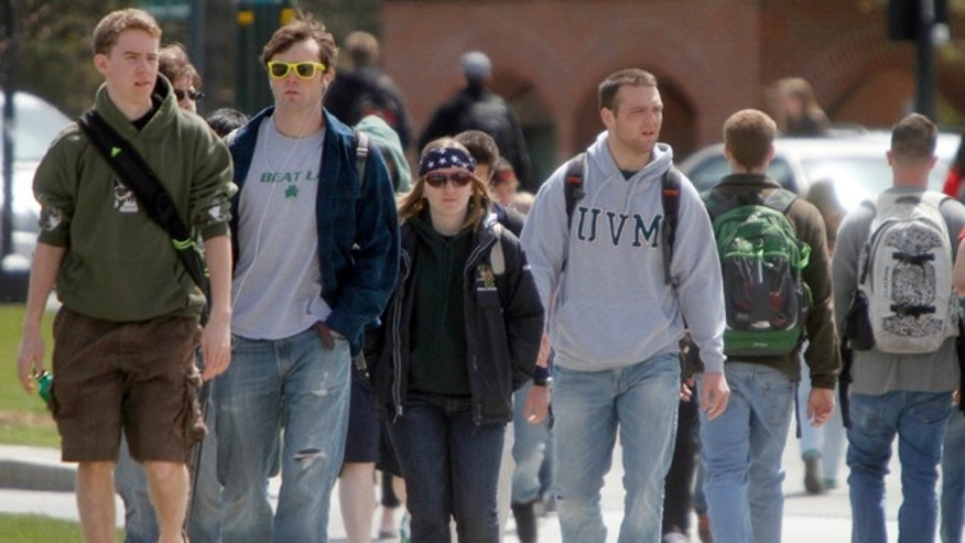 Students walk across campus at the University of Vermont on Monday, April 30, 2012 in Burlington, Vt. U.S. Rep. Peter Welch is compiling stories about student debt. Welch was at the University of Vermont on Monday where he met with students, some of whom are working multiple jobs and studying full time as they accumulate student loan debt. In Vermont, almost 70 percent of college graduates have an average of $30,000 in debt. (AP Photo/Toby Talbot)