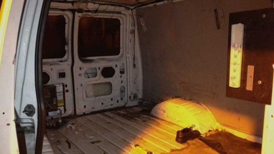 In this photo provided by the U.S. Border Patrol, the inside of the van is shown where a Mexican national driver and his 34 passengers were found trying to enter the U.S. illegally.