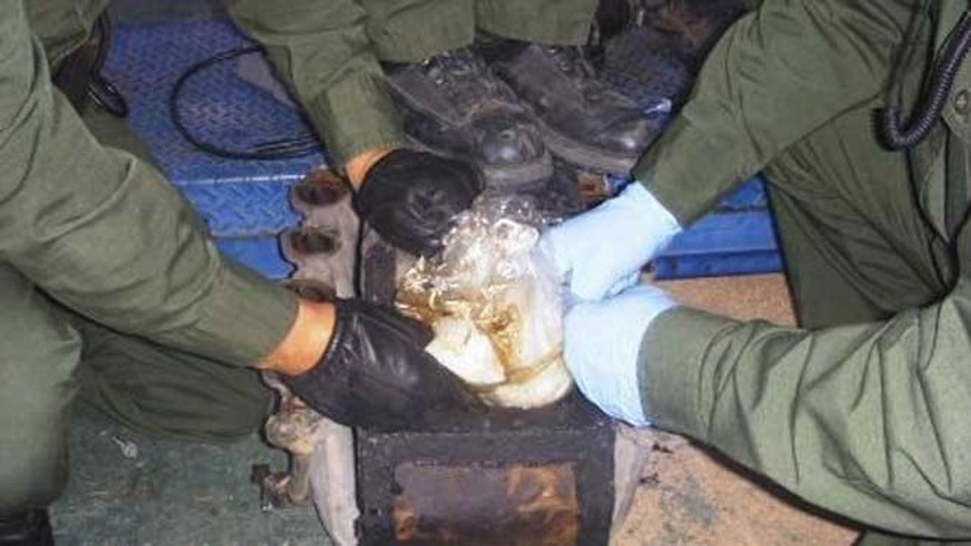 In this photo provided by the U.S. Border Patrol, methamphetamine discovered inside a compartment inside a Ford truck is shown.