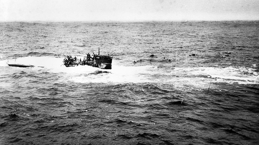 This April 16, 1944 photo provided by the U.S. Navy, posted on a U.S. Coast Guard web site, shows crewmen of German submarine U-550 abandoning ship in the Atlantic Ocean.