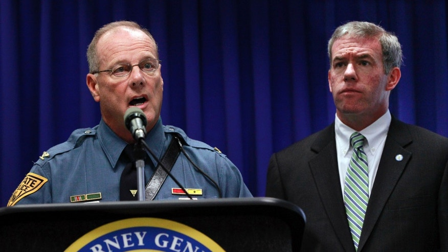 July 27, 2012: New Jersey Attorney General Jeffrey S. Chiesa, right, looks on as State Police Superintendent Colonel Rick Fuentes answers a in Trenton, N.J.