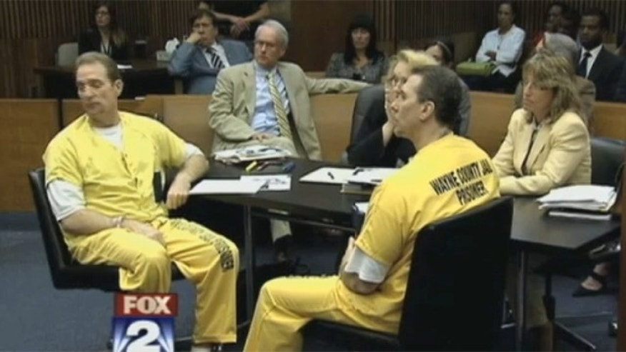 July 30, 2012: The courtroom listens to the judge.