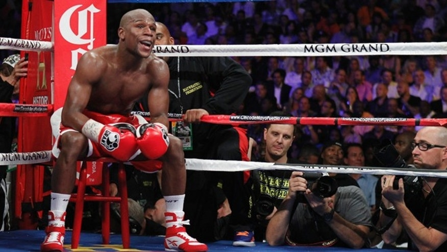 May 5, 2012: Floyd Mayweather Jr. of the U.S. sits on a stool as he waits for a round to start during his title fight against WBA super welterweight champion Miguel Cotto of Puerto Rico at the MGM Grand Garden Arena in Las Vegas, Nevada.