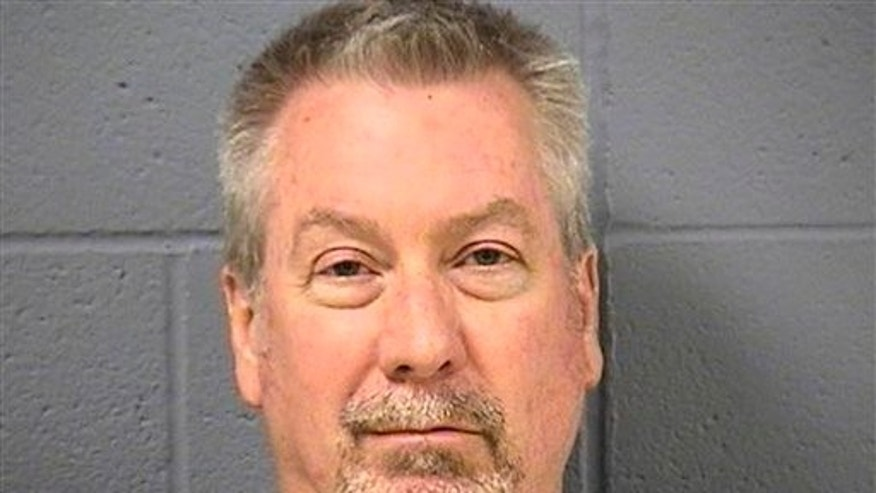 FILE - In this May 7, 2009 file booking photo provided by the Will County Sheriff's office in Joliet, Ill., former Bolingbrook, Ill., police officer Drew Peterson is shown. Peterson is charged with first-degree murder in the 2004 drowning death of his former wife Kathleen Savio. Opening statements in his trial are scheduled to begin Tuesday, July 31, 2012. (AP Photo/Will County Sheriff's Office, File)
