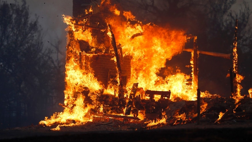 Aug. 3, 2012: A home burns during a large wildfire.