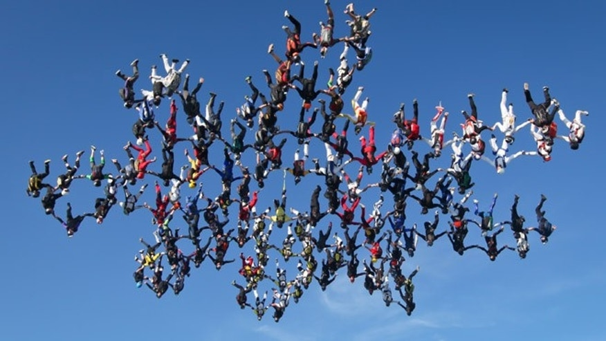 Aug. 3: In this image provided by Brian Buckland, 138 skydivers form a massive snowflake formation over Ottawa, Ill.