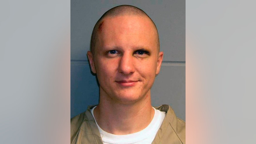 FILE photo released by the U.S. Marshal's Service of Jared Lee Loughner, the suspect in the Tucson shooting rampage.