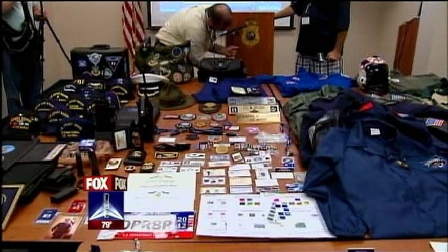 Aug. 6, 2012: A stash of fake IDs and uniforms is shown.