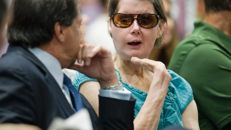 Aug. 10, 2012: Charla Nash, right, talks with attorney Bill Monaco before a hearing at the Legislative Office Building in Hartford, Conn.  Nash who was mauled in a 2009 chimpanzee attack is attending a hearing to determine whether she may sue the state for $150 million in claimed damages.