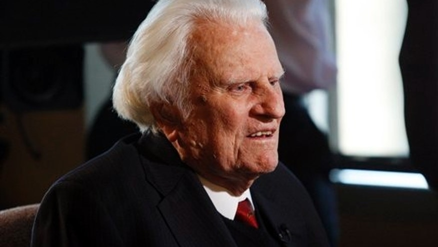 Evangelist Billy Graham, 92, is interviewed at the Billy Graham Evangelistic Association headquarters in Charlotte, N.C., on Monday, Dec. 20, 2010. Graham and his son, Franklin, had lunch with former President George W. Bush and former first lady Laura Bush before a book signing where the Bushes were promoting their respective books. (AP Photo/Nell Redmond)