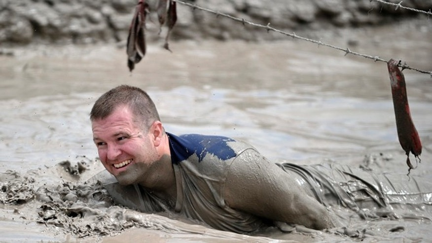 June 17, 2012: Jeffrey Boehmer makes his way through the Muddy Mayhem obstacle at the Warrior Dash at Pocono Raceway in Long Pond, Pa.