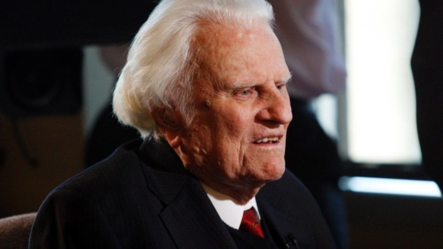 FILE 2010: Evangelist Billy Graham speaks to the media at the Billy Graham Evangelistic Association headquarters in Charlotte, N.C.